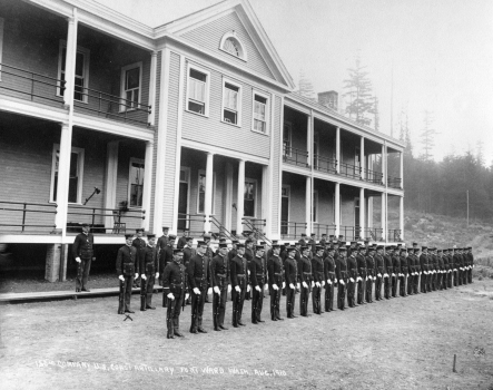 Soldiers stand at attention outside Fort Ward's main barracks. The building survived at the corner of Parkview Drive and Hilltop Drive until the 1980s.
