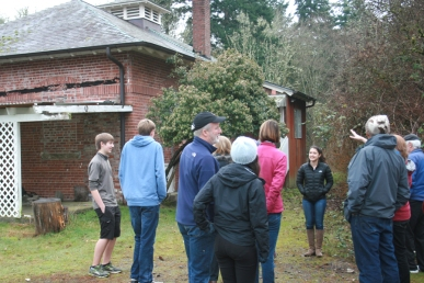 Members of the Bainbridge Island Parks Foundation discuss the historic bakery building during their recent site visit.