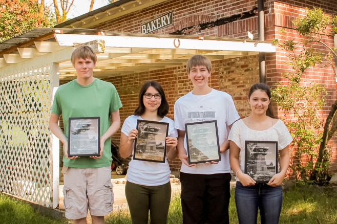 The Fort Ward Youth Advisory Committee display their Blakely Awards at the historic bakery building, future home of the Fort Ward Community Center. Click the photo to read the story in the Bainbridge Island Review newspaper. (Photo courtesy of Leslie Kelly/Bainbridge Island Review.)