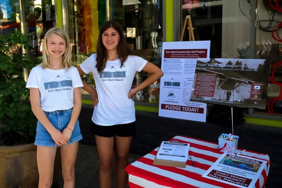 The newest members of the Fort Ward Youth Advisory Committee, Stella Streufert (left) and Mallory Browne, at the July 3 Street Fair.