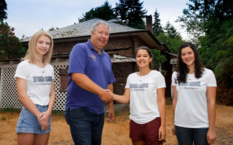Fort Ward Youth Advisory Committee members Stella Streufert, Kate Merifield and Marina Ikuse with Curt Carlisle of Bainbridge Heating and Air.