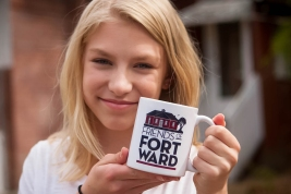 Stella models the original Friends of Fort Ward coffee mug.