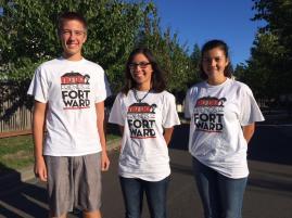 Erik, Aila and Marina model their Fort Ward T-shirts.