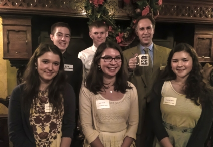 The Fort Ward Youth Advisory Committee with Chris Moore, executive director of the Washington Trust for Historic Preservation, before the great hearth of the historic Stimson-Green Mansion in Seattle. The WA Trust grant was awarded a holiday gala Dec. 9.