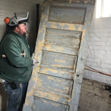 Casey and one of the bakery's original doors, found under the false floor