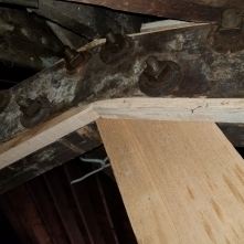 Newly milled fir beams in the bakery rafters