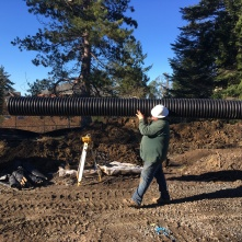 Casey of Bainbridge Parks carries a pipe for the new storm drain
