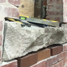 One of the bakery's original sandstone sills, badly damaged