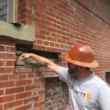 Eric of MRC fills in a void in an exterior wall