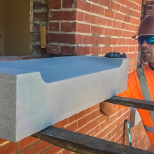 PJ guides the smaller of two new sandstone sills into place