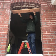 Willy Doyle installing a new window frame