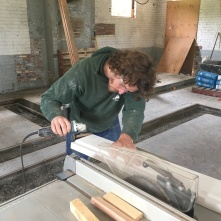 Willy Doyle of the Park District crafts window frames for the bakery